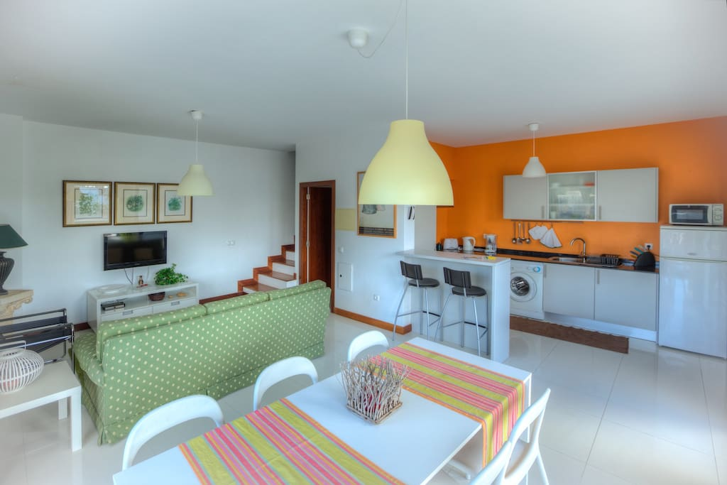 Living and dining areas + kitchen.