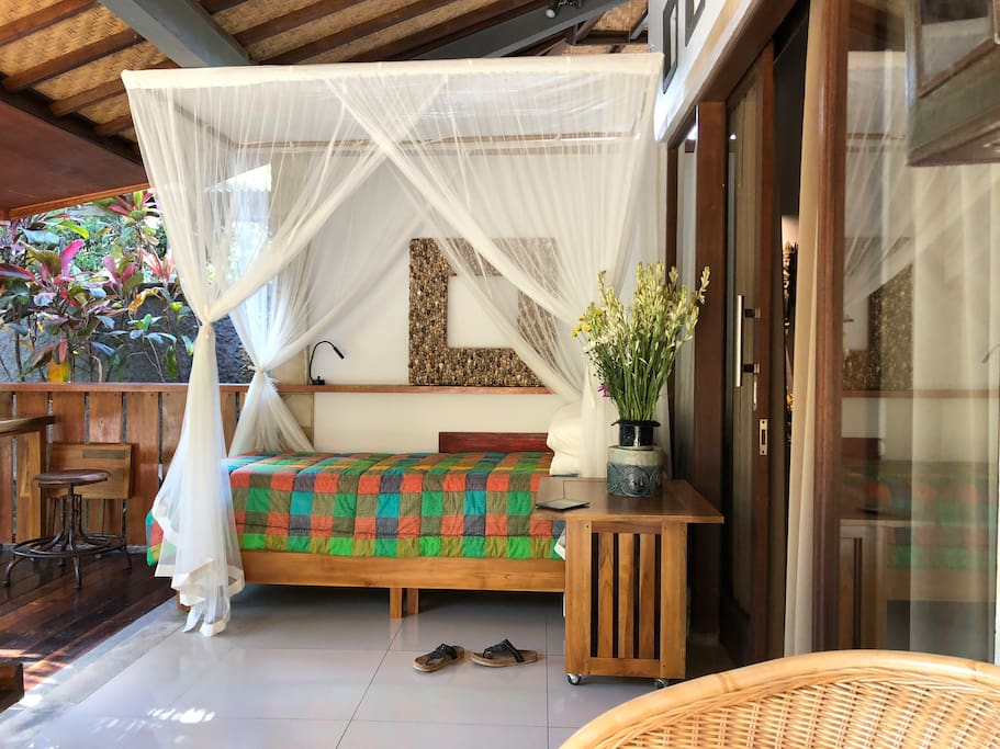 This bed can be either a twin bed, a single bed or a sofa. With the mosquito net,  it is very nice to sleep outside on the veranda. Cool fresh air and quiet sounds from the garden