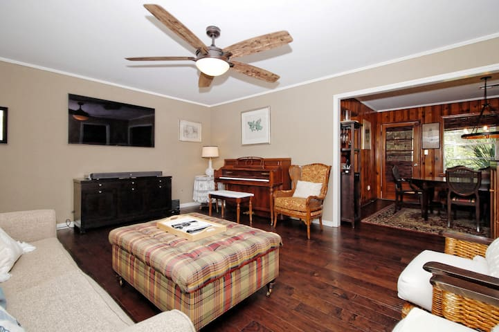 Open living room with ample light and a large TV with over 200 DirecTv channels.