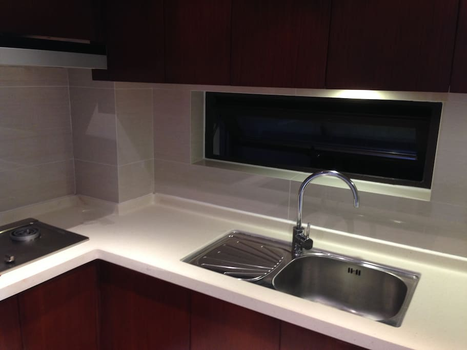 fully furnished kitchen with fridge and stove