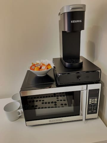 Includes microwave, Keurig coffee maker, and mini-fridge.