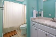 Upstairs bathroom with tub for rooms 1 and 2