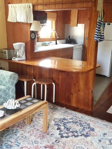 VIew of kitchen with handmade kitchen table.