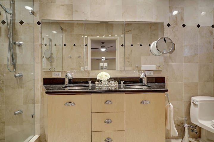 Spacious Dual marble vanity in second master so easy to share with multiple couples