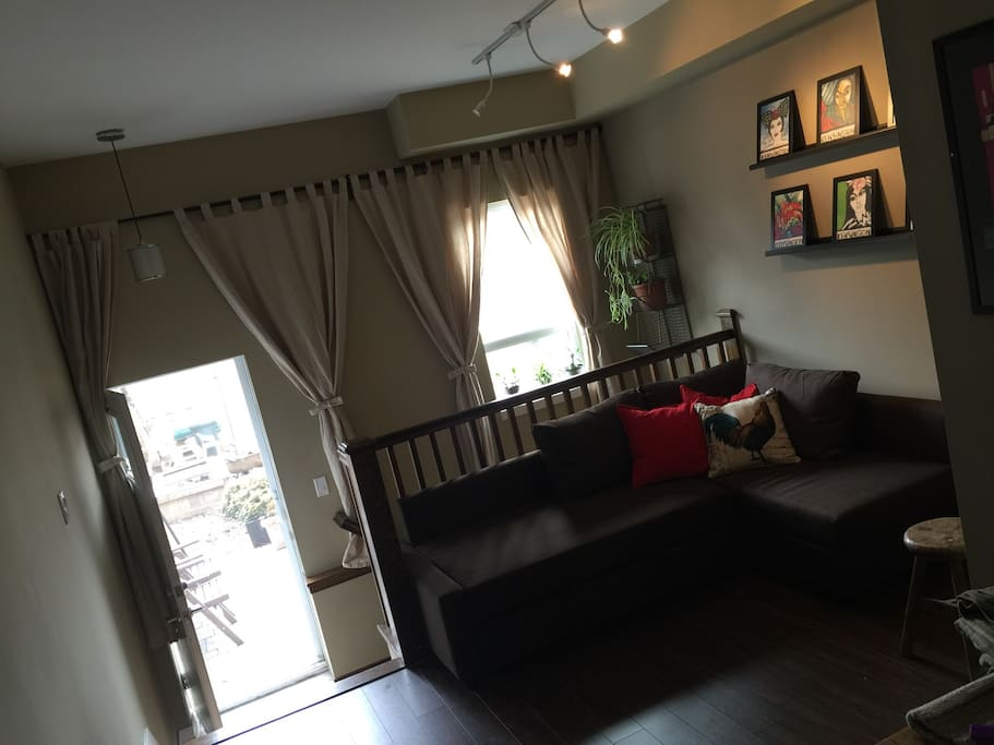 Living room with brand new sofa bed that sleeps two comfortably. The back door leads to a full yard with a patio and two parking spots