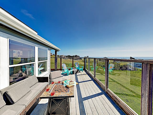 A private deck offers amazing ocean views and ample seating options.