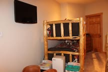 Bedroom 1: Twin-sized bunk beds and children's play kitchen
