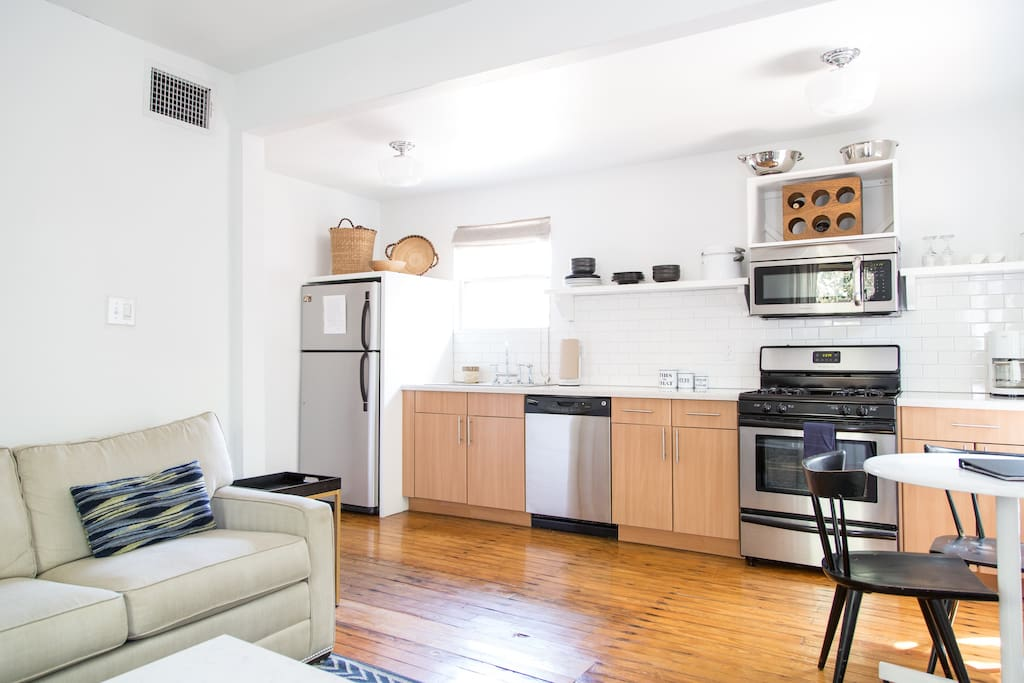 Freshly renovated kitchen fully equipped with gas range, dishwasher,  cookware and complimentary local-roasted coffee