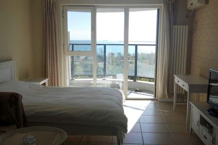 东戴河止锚湾附近山海同湾海景公寓大床房 - 葫芦岛市