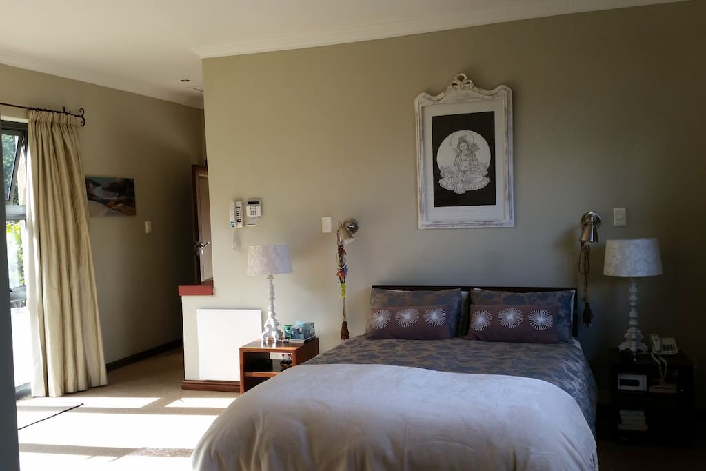 One of the 4 bedrooms with queen size bed
