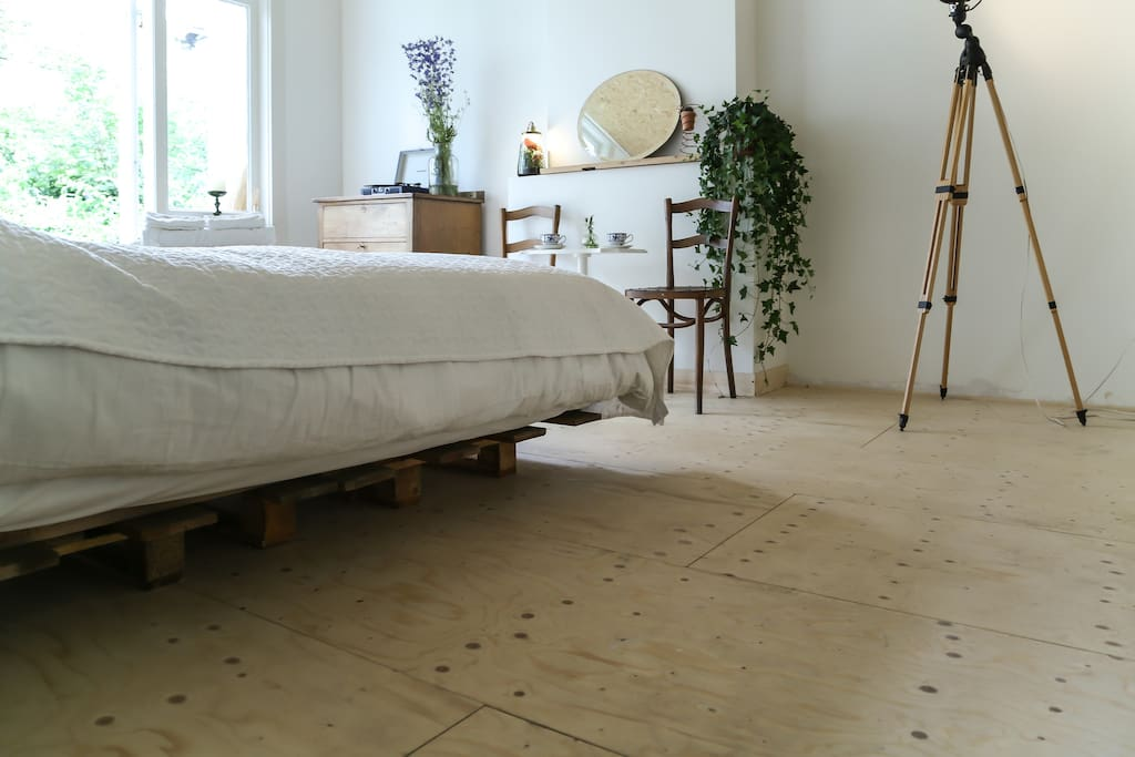 The bed is made from wooden pallets with a boxspring mattress and top mattress on top. It is super comfortable!