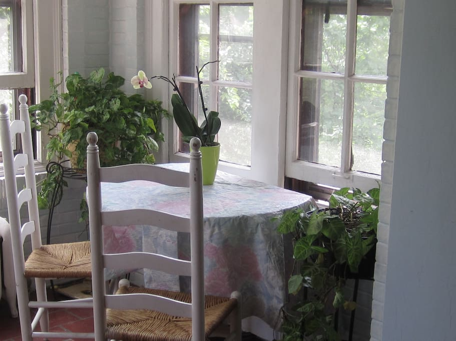 Tranquil sunporch is a nice place to have morning coffee of set up your mobile office.