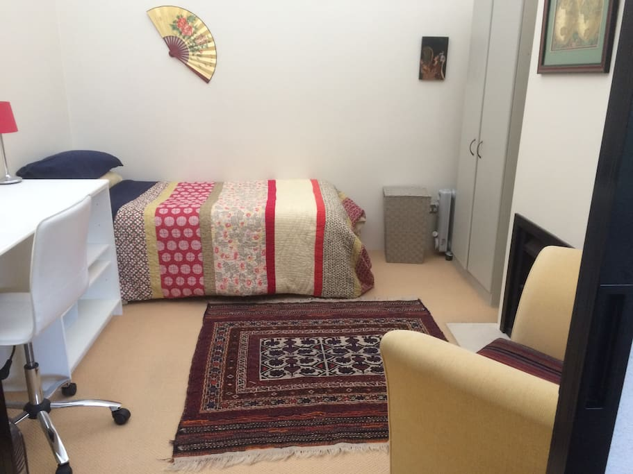 Snug room - located in the centre of the house; has large desk; wardrobe, drawers and its own gas fireplace