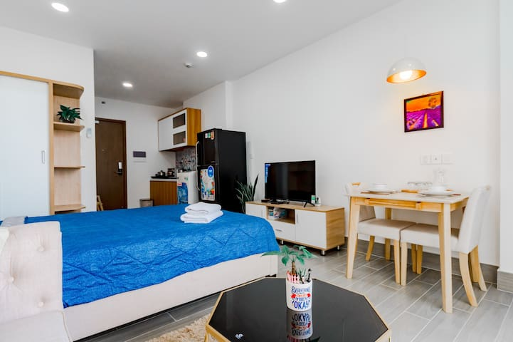 Your room with natural light, queen size bed, working desk, wardrobe, fridge, private bathroom, clean beddings and towels.