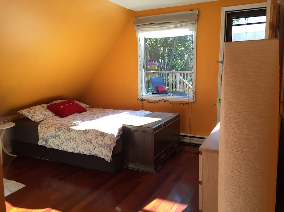 Lots of light in bedroom w/ window looking out onto deck.