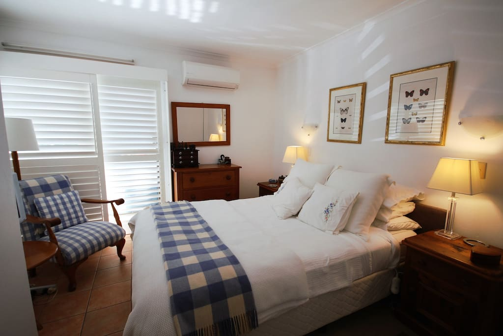 Master bedroom with queen size bed and air conditioning and TV