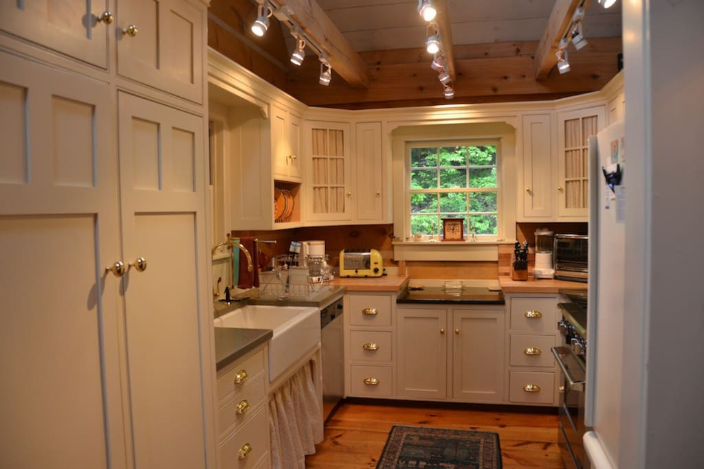 Kitchen has vaulted ceiling, skylights, professional stove.
