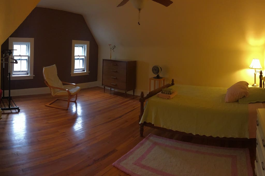 Full-size bed, hardwood floors and ceiling fan