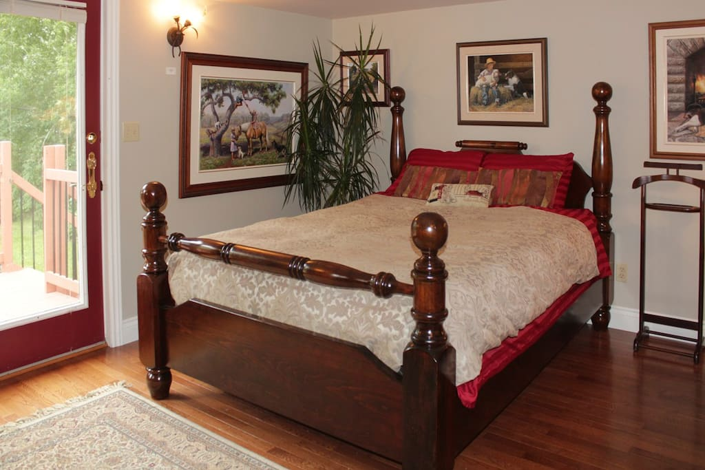 Your comfy down filled duvet on a new queen sized bed, with deck and private entrance overlooking Fish Lake and woodlands. All paintings by Mia Lane
