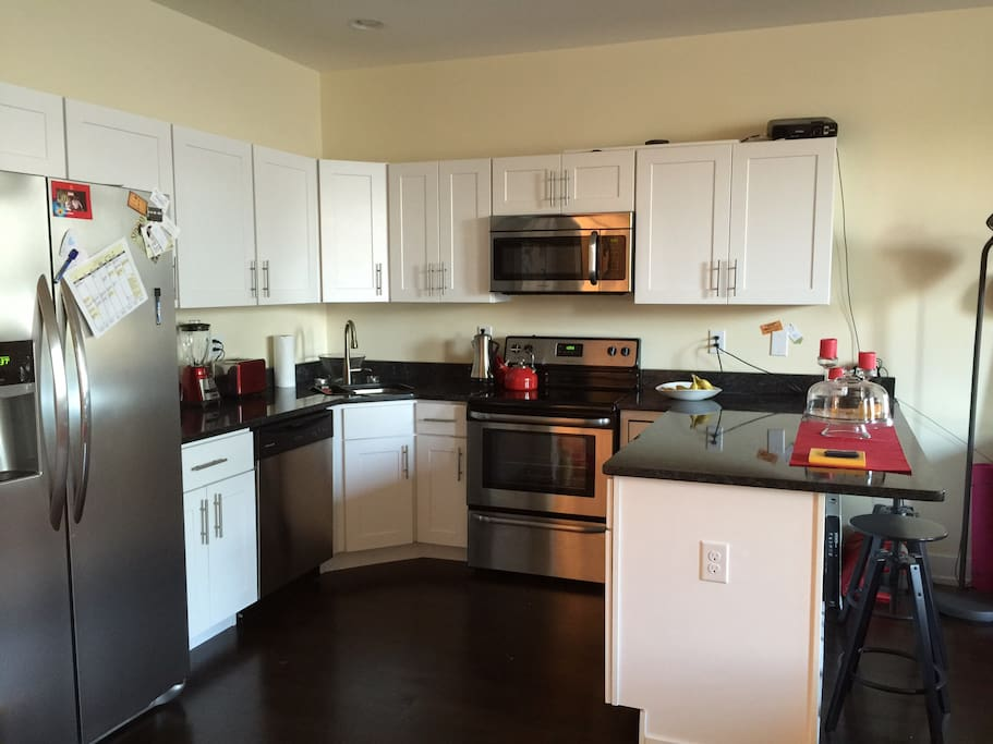 kitchen with complete access to  utilities.(fridge, microwave, oven, dishwasher, ext)