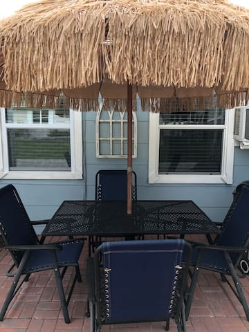 Plenty of thatched island style patio dining sets throughout blue starfish beach resort