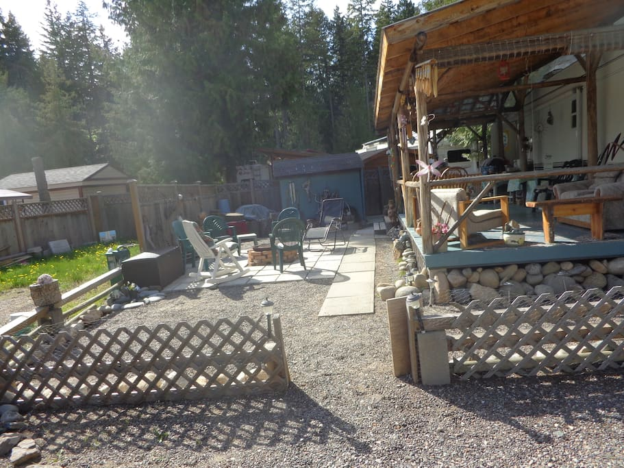 Large covered deck, patio, fire pit and fenced