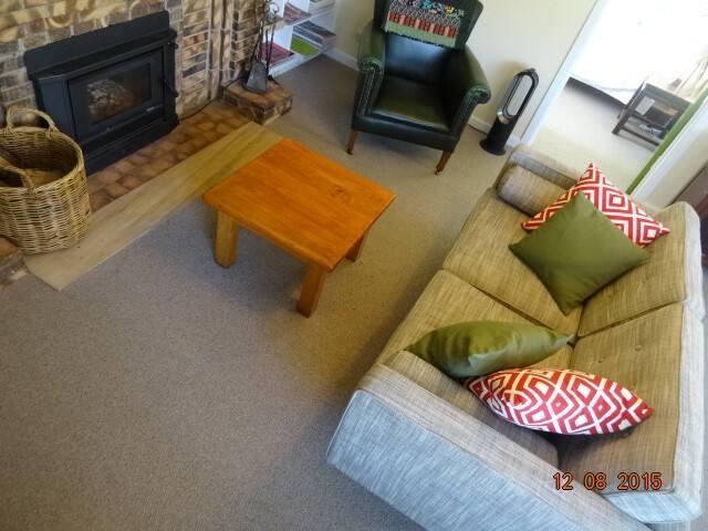 Lounge room with wood burner