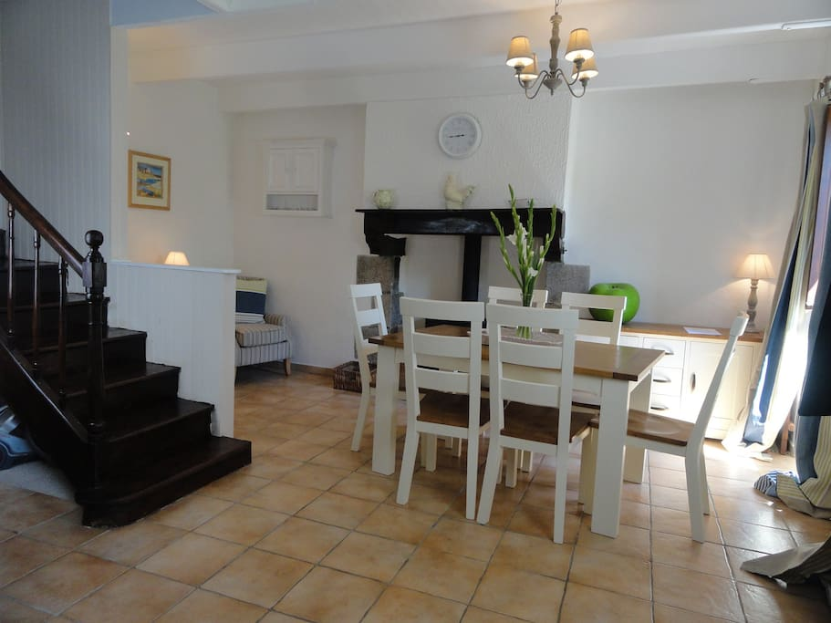 Downstairs of Granary has a family dining area and seating area to enjoy the wood-burning stove