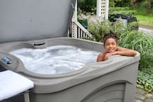 Soak your cares away in our 4 person hot tub right outside the door to the unit set at a soothing 102 degrees