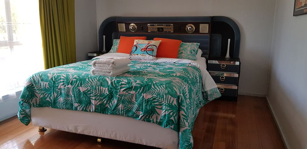 This is the 1st bed room. This retro bed head has a comphertable mattress and hotel quality bed Linen to assure you have a good night sleep.