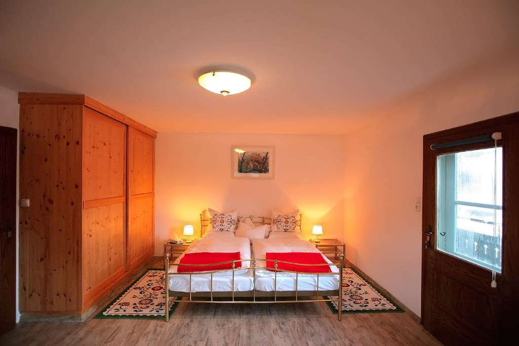 Double bedroom with balcony and lake view