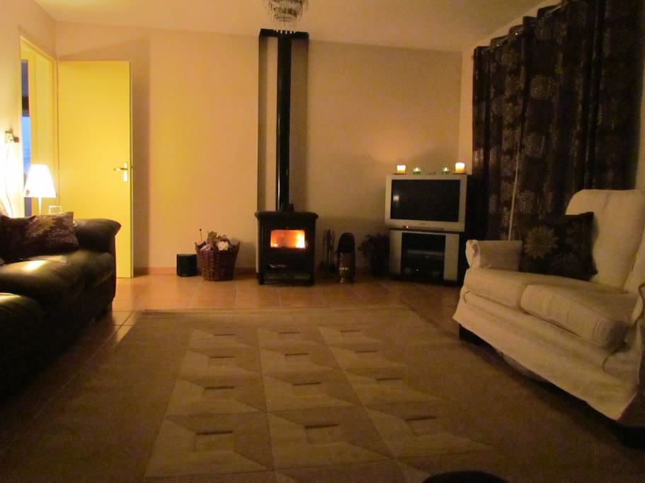Cosy lounge has log burner and seating for 8.