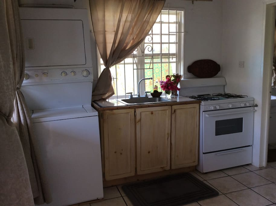 Fully stocked kitchen with full size washer and dryer