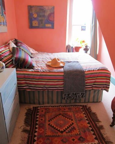 Peaceful double in artist's big colourful house