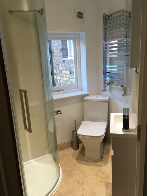 lovely bathroom with rainfall shower cabin, heated towel rail