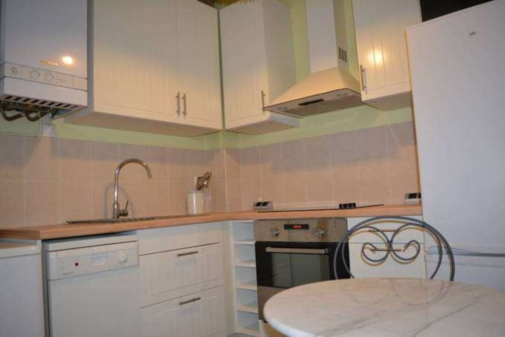 Fully furnished kitchen with dishwasher and oven