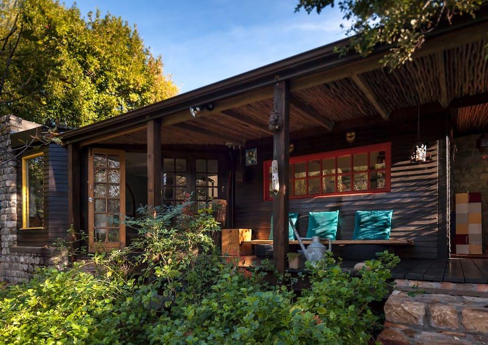 The studio veranda overlooking the garden and mountains