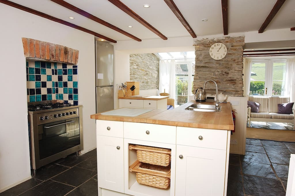 Well equipped kitchen leading onto conservatory