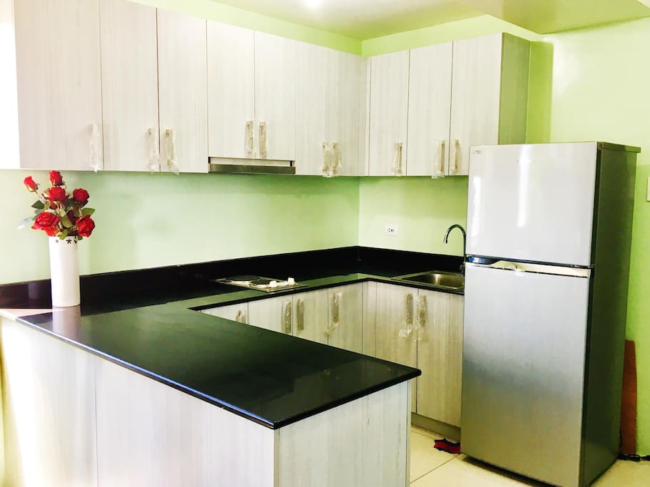 Refrigerator and electric stove top is available to use in the kitchen.
