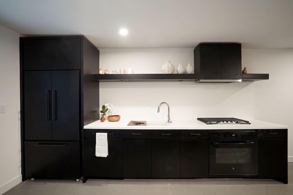 Kitchen - paneled dishwasher and fridge