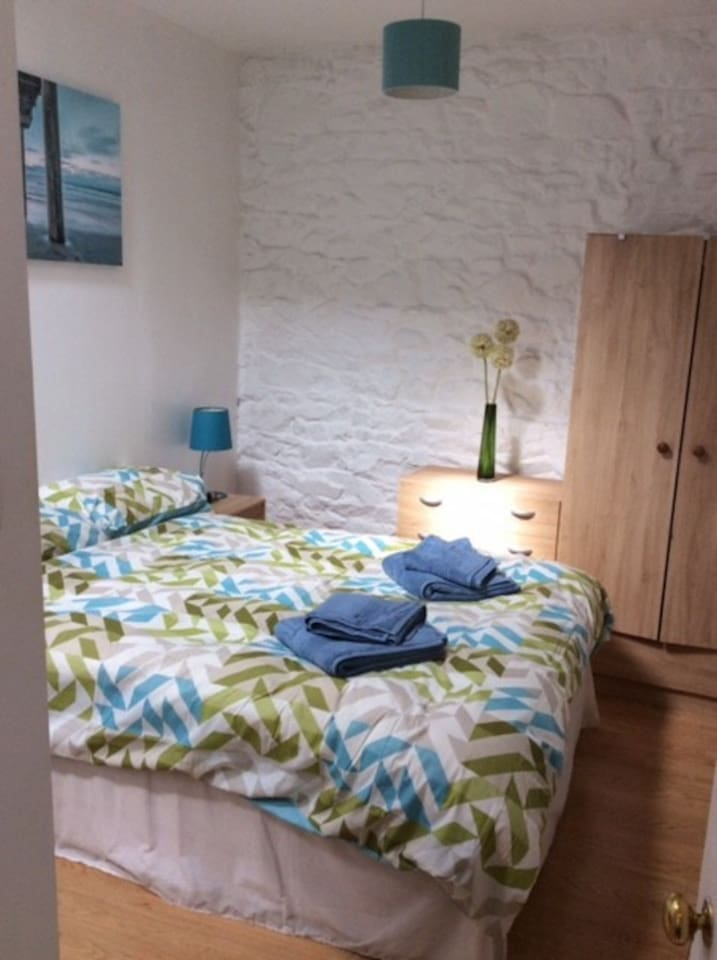 Spacious bedroom, two chest of drawers and wardrobe available for storage.