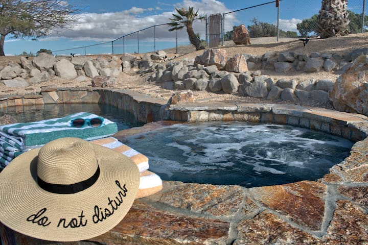 8 person salt water spa, cascades into the pool.