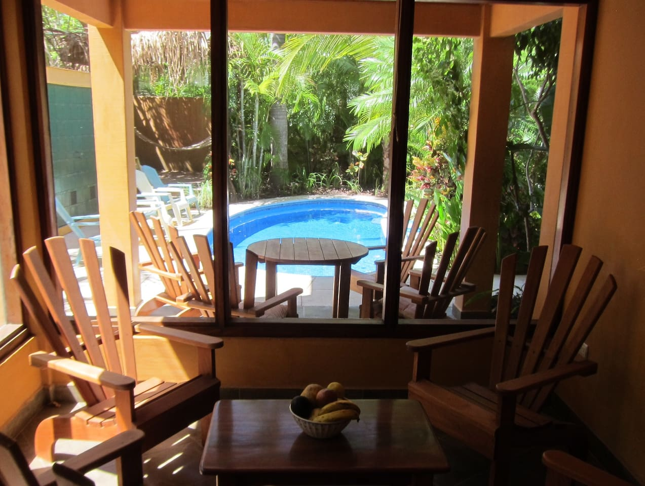 Looking out from the Master bedroom onto a fully screened porch that opens to the pool area