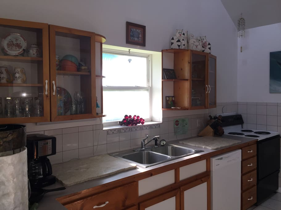 full kitchen with nice window looking to back yard
