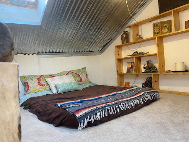Loft with skylights and bookshelves.  NO CHILDREN allowed in loft under any circumstances