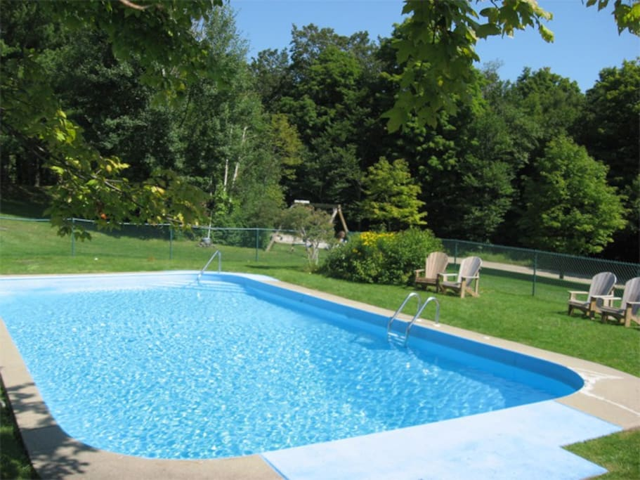 Summer only: The building's communal outdoor pool - open during the summer months. One of a very few buildings in the area with an outdoor pool! Grills for BBQs and an outdoor fire pit are close by. The pool is just a few feet from our private patio.