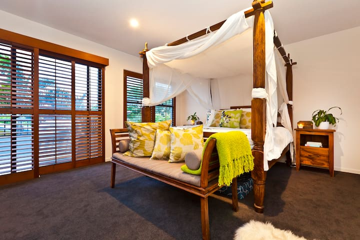 Stunning upstairs master bedroom with king bed, ensuite, walk-in robe and private balcony