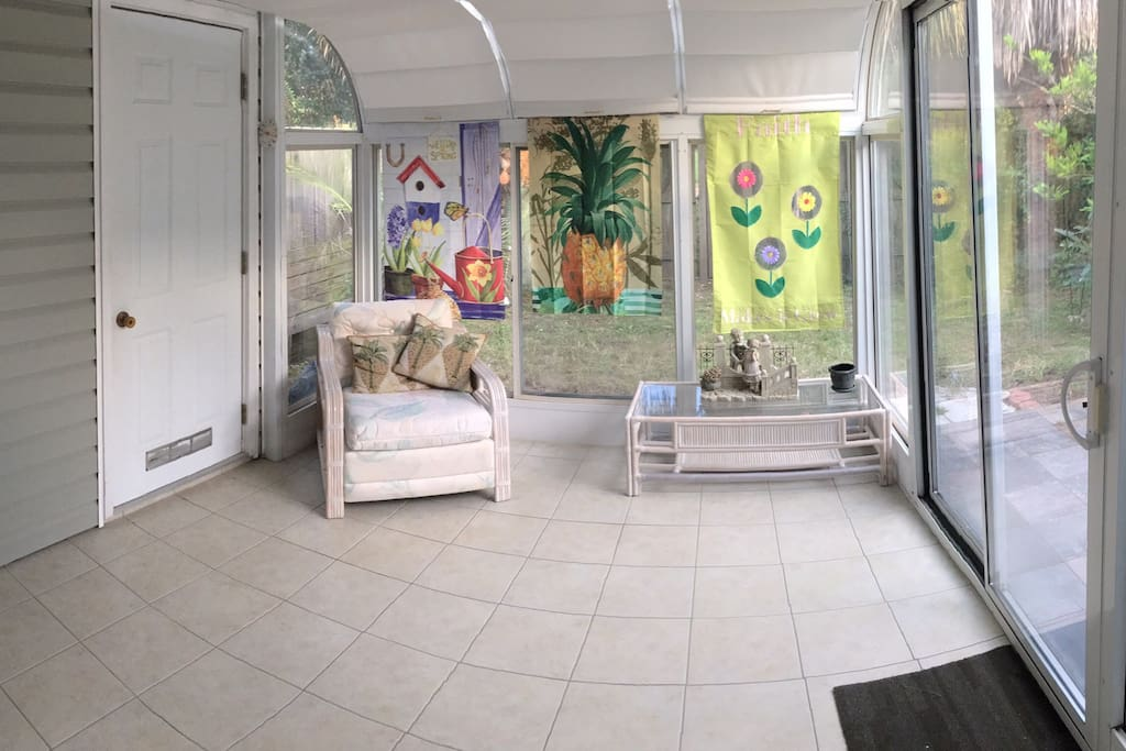 Beautiful sunroom open to private backyard