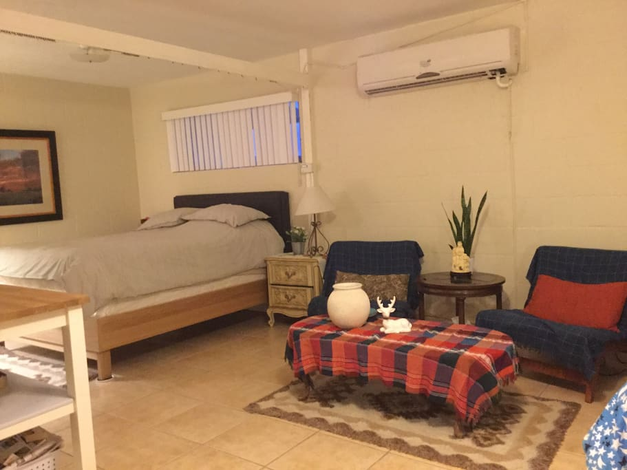 Two lounge chairs separated the queen bed (shown here) and the twin bed (shown in previous photo) in the living space.