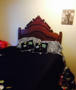 Kirkland room with a queen size bed